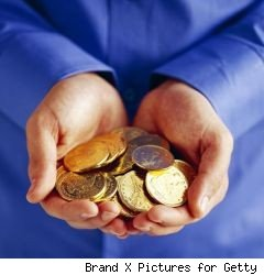 two hands holding gold coins