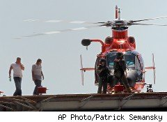 Two of the crew members rescued from the Vermillion oil rig that caught fire in the Gulf of Mexico on Thursday, left.