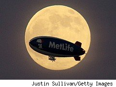 blimp with the moon as a background