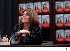 Sarah Palin's publisher, HarperCollins, has settled its lawsuit with Gawker, which posted leaked images of pages from Palin's new book,