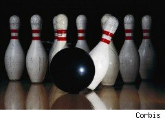 Bowling ball hits pins