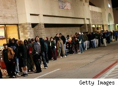 an early morning Black Friday crowd lines up outside a store