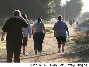 obese teenagers walking down a trail