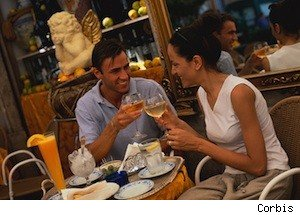 couple eating at a restaurant, happy