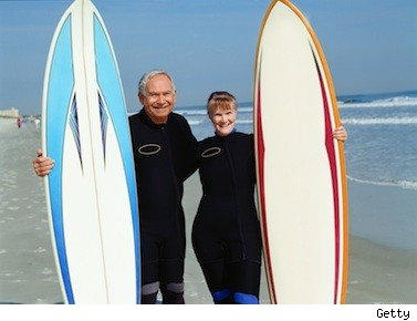 retired couple with surfboards