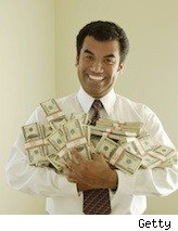 businessman with bundles of cash in his arms