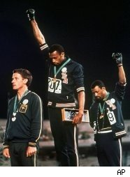Tommie Smith and John Carlos give Black power salute during an awards ceremony at the 1968 Summer Olympics