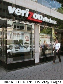 Woman walks in front of a Verizon Wireless store
