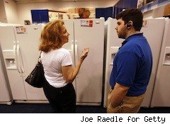 woman talks to an appliance salesman