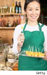 grocery sample girl in green apron - take a job, any job, after college