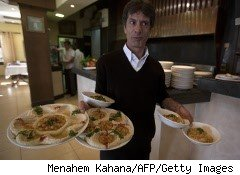 Waiter delivers plates of food