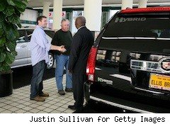 a man buys a Cadillac Escalade from a dealer