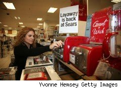 Woman shops for a toaster at Sears