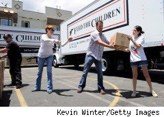 Volunteers loading trucks for Feed the Children