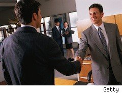 a young man shake's a job interviewer's hand