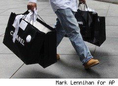man totes two big Chanel bags - best credit cards for shopping sprees post