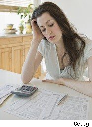 lady looking worried over her taxes