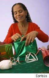 lady opening a present - after christmas sales