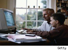 a kid and a dad look at a computer -- sold kids data