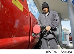 Man pumps gas into his truck