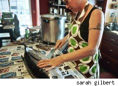 woman works in the kitchen - single income