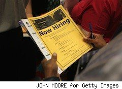 person looking at jobs flier
