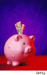 a piggy bank stuffed with cash - lower your bank costs