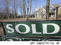 sold sign in front of wintery looking house - home sellers 2011