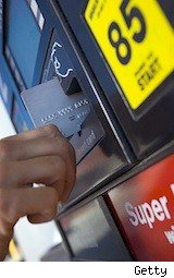 man swiping card at pump - save at pump