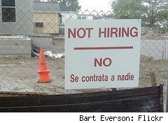a not hiring sign in English and Spanish - finding a job