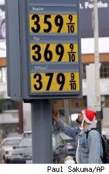 Man checks gas prices in San Francisco in December