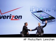 Verizon Wireless CEO Dan Mead, left, and Apple COO Tim Cook announce that Verizon will carry Apple's iPhone.