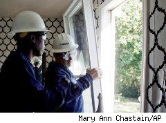 Workers install energy efficient windows