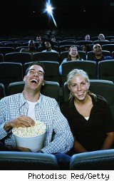 Couple enjoying popcorn at the movies