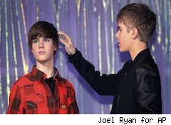Justin Bieber touches his wax hair
