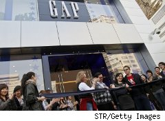 Shoppers outside a Gap store
