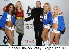 Paul Mitchell CEO John Paul DeJoria poses with his wife, Eloise Broady DeJoria, and the Dallas Cowboys.