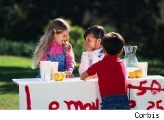 Kids earn money at a lemonade stand