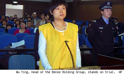Wu Ying, head of the Bense Holding Group, stands on trial. AP