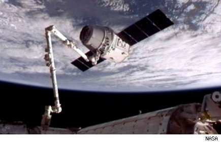 Dragon Private Spacecraft Docks at Space Station