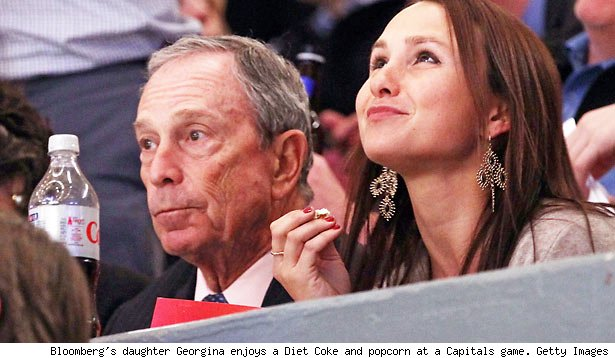 Bloomberg's daughter Georgina enjoys a Diet Coke and popcorn at a Capitals game. Getty Images
