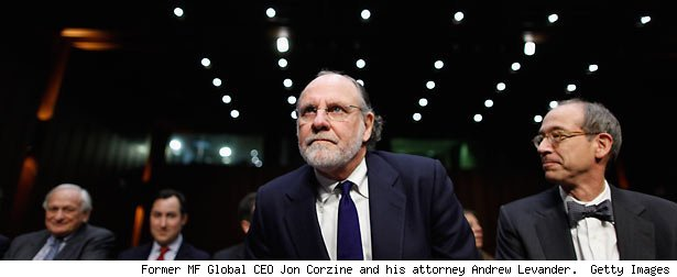 Former MF Global CEO Jon Corzine and his attorney Andrew Levander. Getty Images