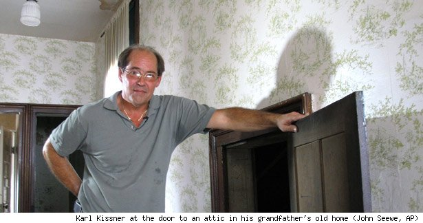 Karl Kissner at the door to an attic in his grandfather's old home (John Seewe, AP)