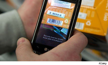 scanning a barcode with a smart phone to compare prices