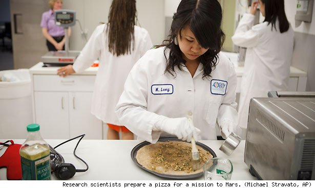 Research scientists prepare a pizza for a mission to Mars. (Michael Stravato, AP)