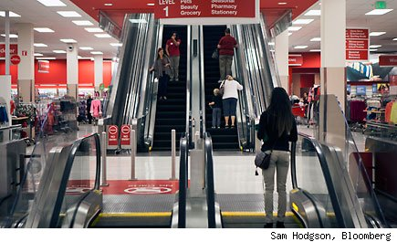Customers stand on an escalator at a new Target Corp. store at the Westfield North County mall on Thursday, Oct. 25, 2012, in Escondido, California, U.S. The U.S. Bureau of Economic Analysis is scheduled to release personal consumption data on Oct. 29. Photographer: Sam Hodgson/Bloomberg