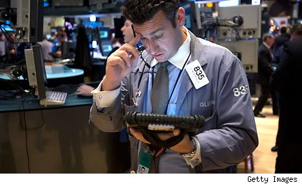 Traders work at the New York Stock Exchange
