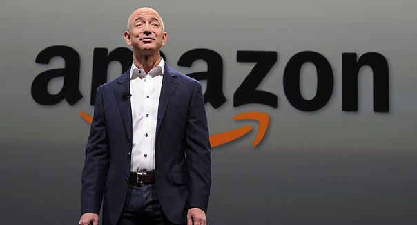 Jeff Bezos  CEO of Amazon introduces new Kindle Paper white during a press conference on September 06, 2012 in Santa Monica, California. The new Kindle Paperwhite eReader will retail for $119 USD and ships October 1. AFP PHOTO/JOE KLAMAR        (Photo credit should read JOE KLAMAR/AFP/GettyImages)