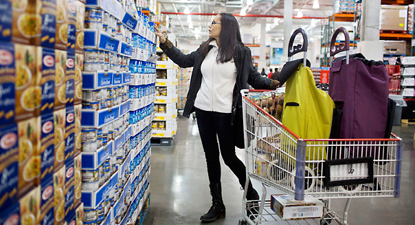 Shoppers buy goods at a Costco store in New York, NY, Monday, March 11, 2013.
