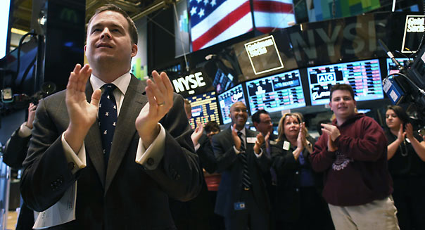 NEW YORK, NY - MARCH 25:  Traders work  the floor of the New York Stock Exchange during late trading on March 25, 2013 in New York City. The Dow Jones Industrial Average closed down 64 points amid renewed worries about Cyprus.  (Photo by John Moore/Getty Images)